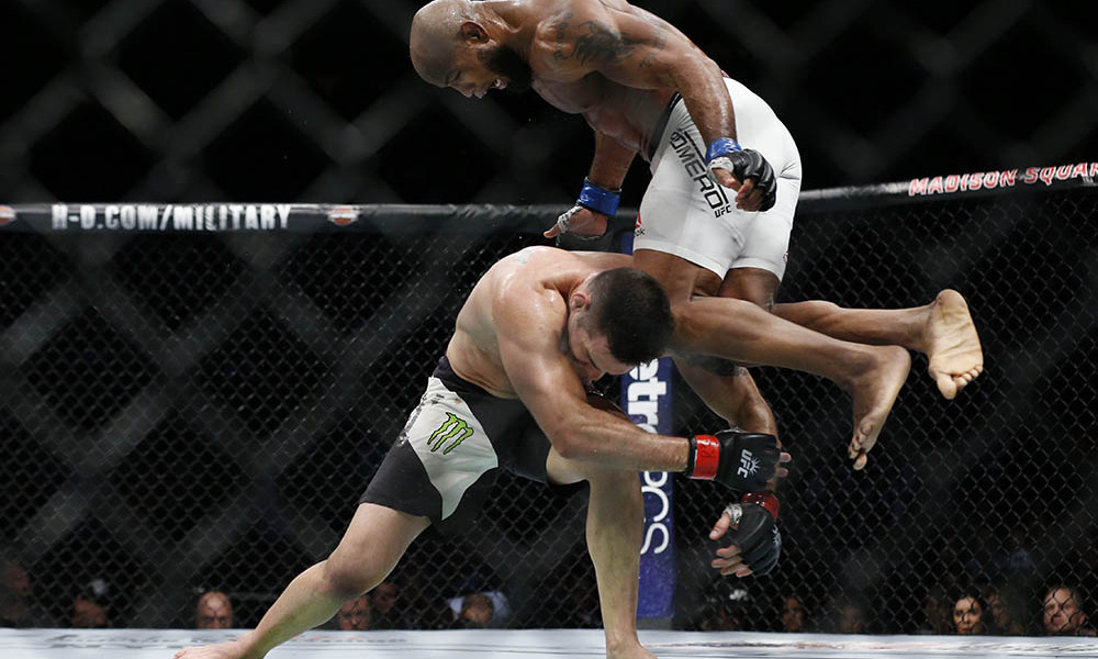 Nov 12, 2016; New York, NY, USA;    Yoel Romero (blue gloves) takes down and defeats Chris Weidman (red gloves) during UFC 205 at Madison Square Garden. Mandatory Credit: Adam Hunger-USA TODAY Sports